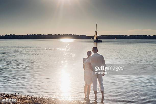 Couple standing at Lake Cospuden in the evening