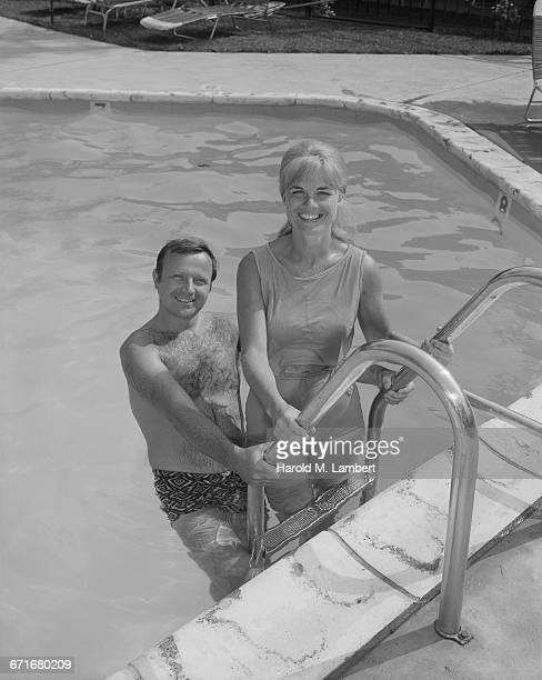 """ couple standing at poolside, portrait"" - number of people stock pictures, royalty-free photos & images"