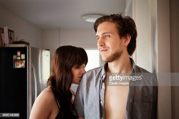 couple standing b y doorway at home - fully unbuttoned stock pictures, royalty-free photos & images
