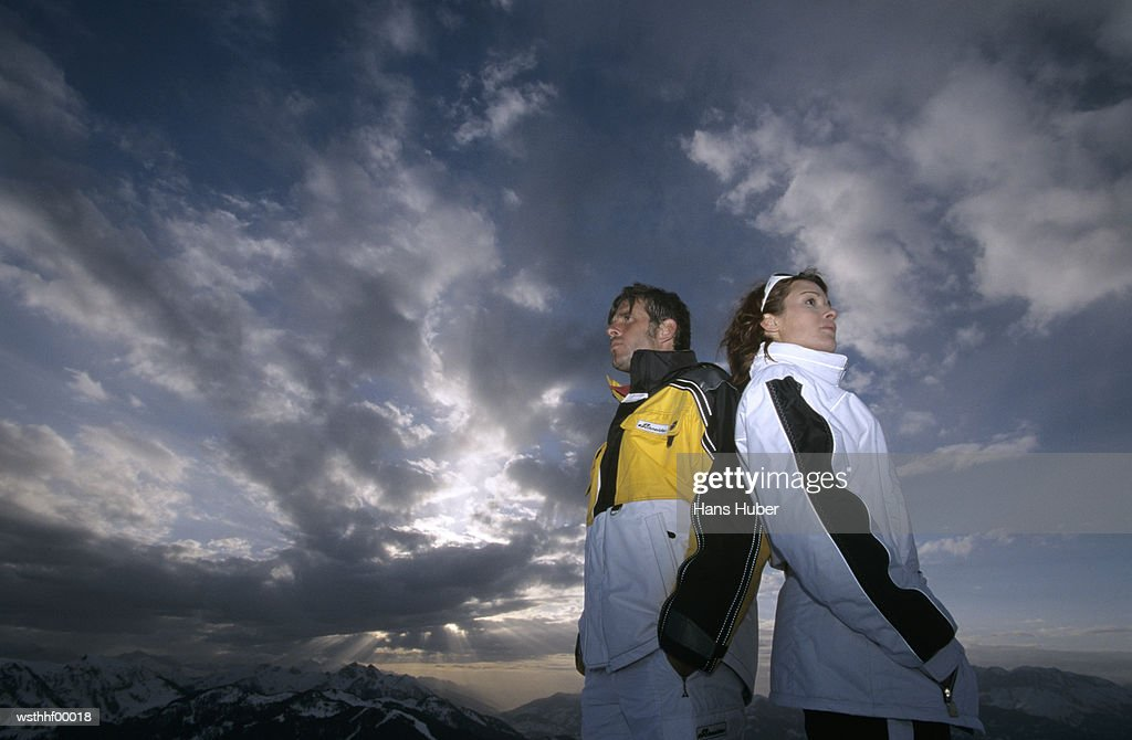 Couple standing back to back : Stock Photo