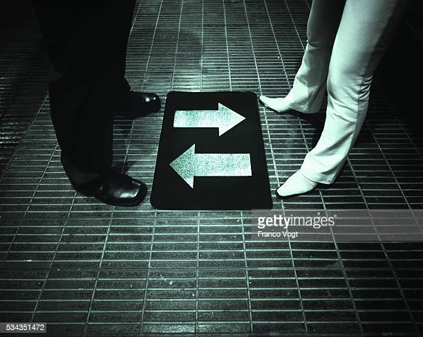 Couple Standing Before Mat with Arrows