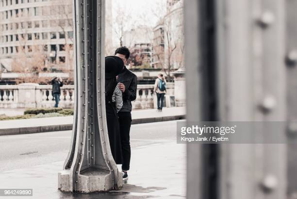 Couple Standing By Column