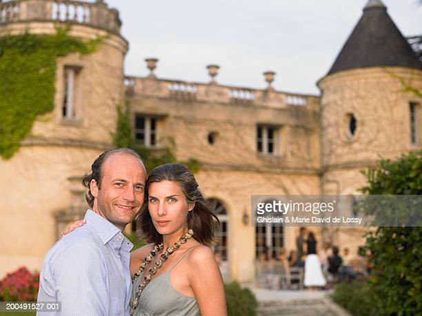 couple standing in grounds of stately home, smiling, portrait - saint ferme stock photos and pictures