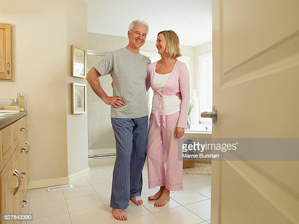 Couple standing in their bathroom