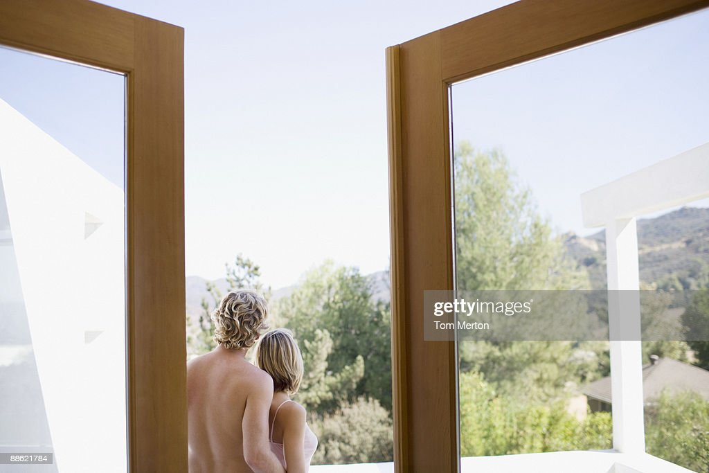 Couple standing on backyard patio : Stock Photo