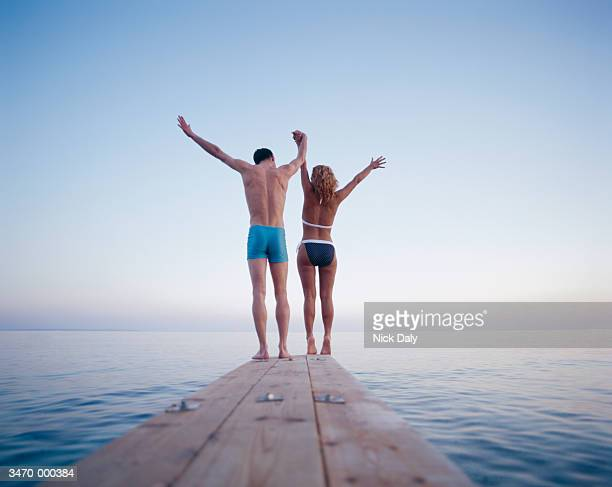 Couple Standing on End of Pier
