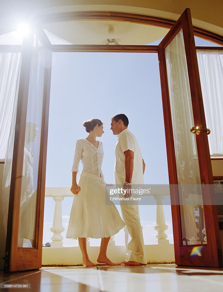 Couple standing on hotel balcony : Stock Photo