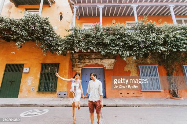 couple standing on road by building - cartagena colombia foto e immagini stock