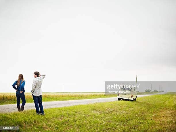Couple standing on side of rural road