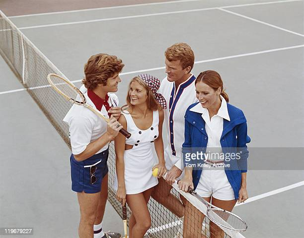 couple standing on tennis court, smiling - 1973 stock pictures, royalty-free photos & images