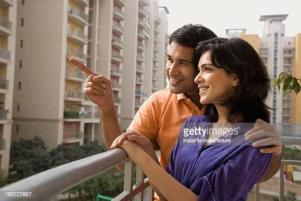 Couple standing on the balcony