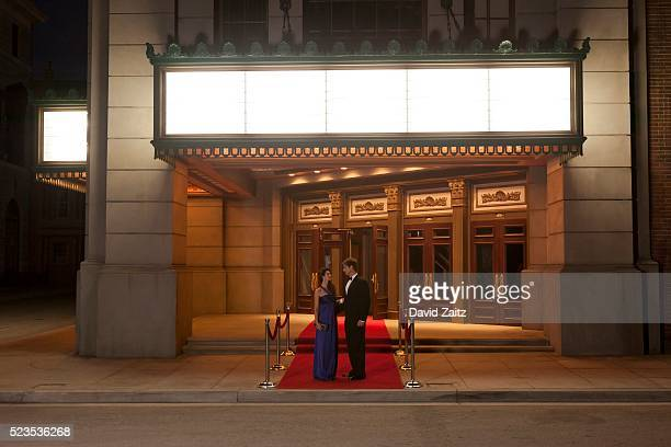 Couple standing on the red carpet