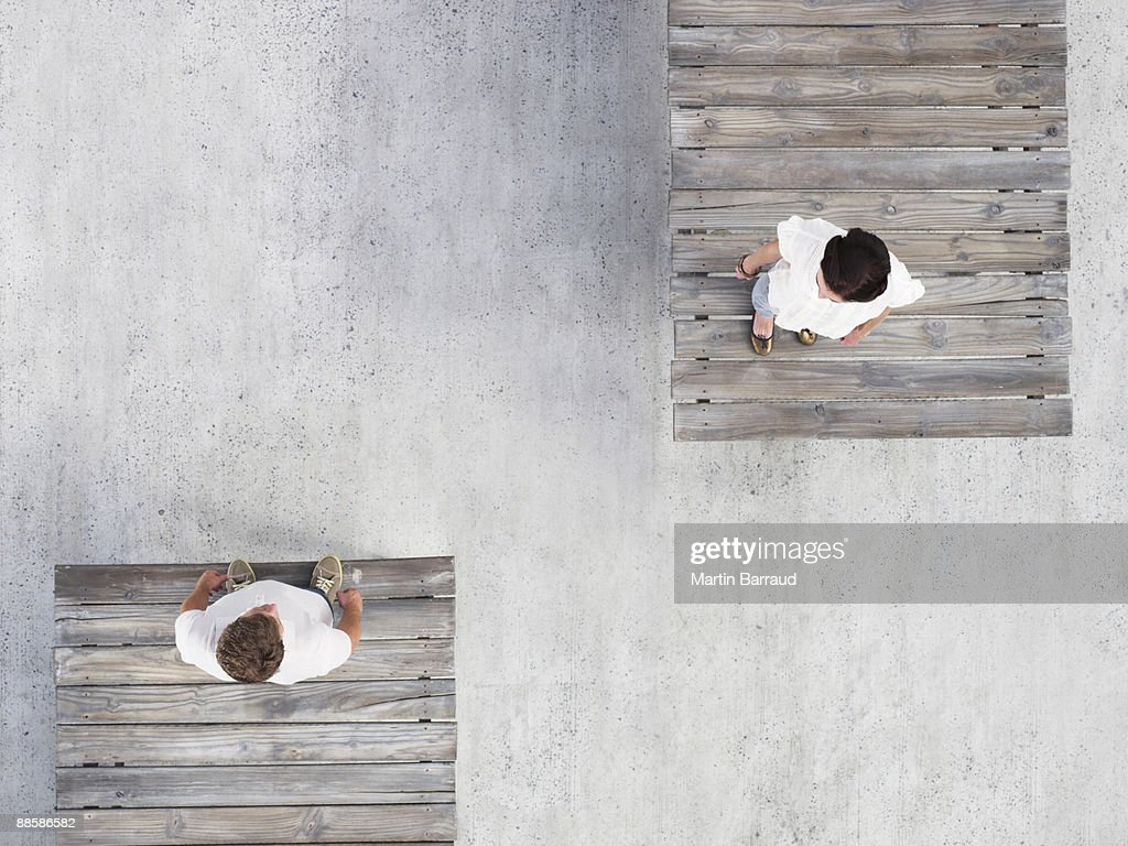 Couple standing on wooden docks : Stock Photo