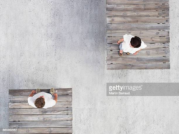 Couple standing on wooden docks