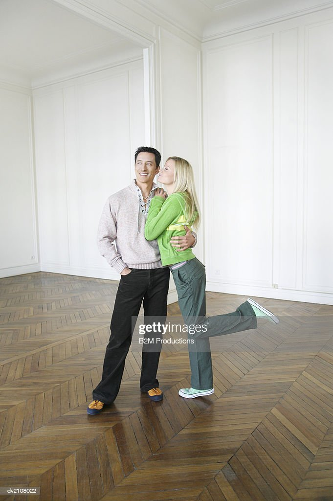 Couple Standing on Wooden Floor in an Empty House : Stock Photo