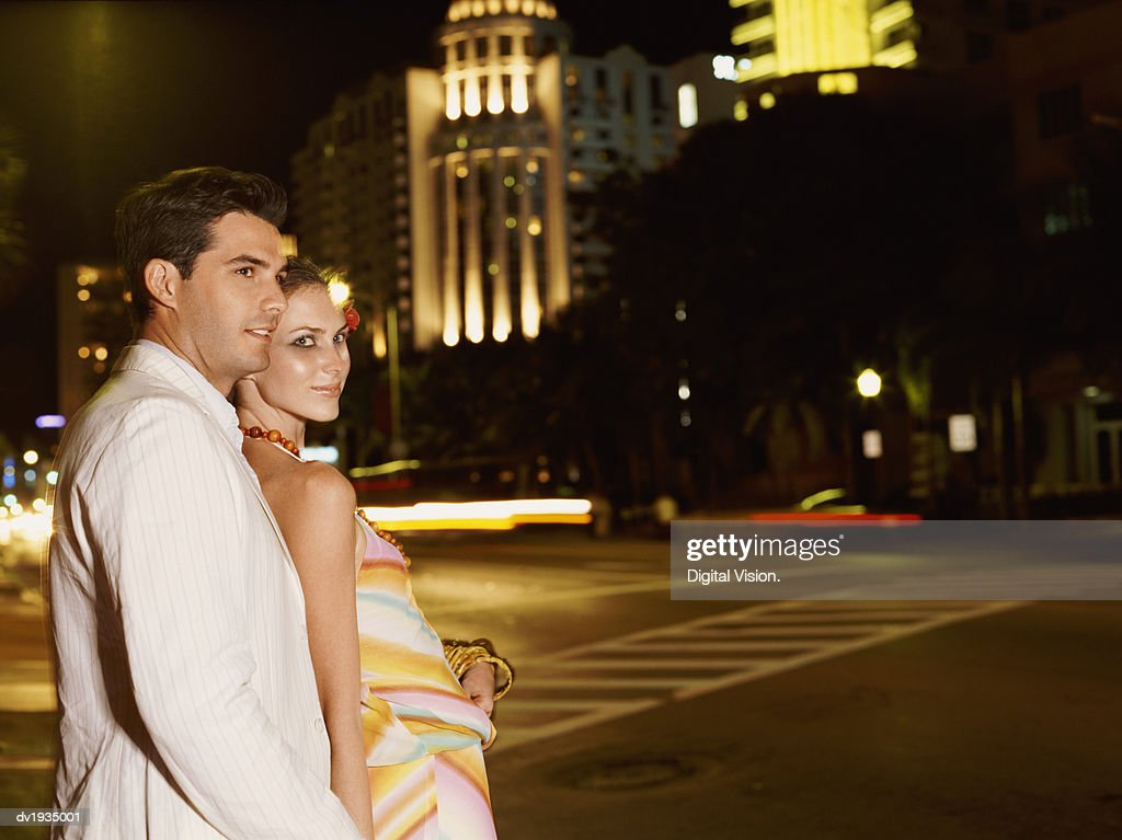 Couple Standing Outdoors by a Road : Stock Photo