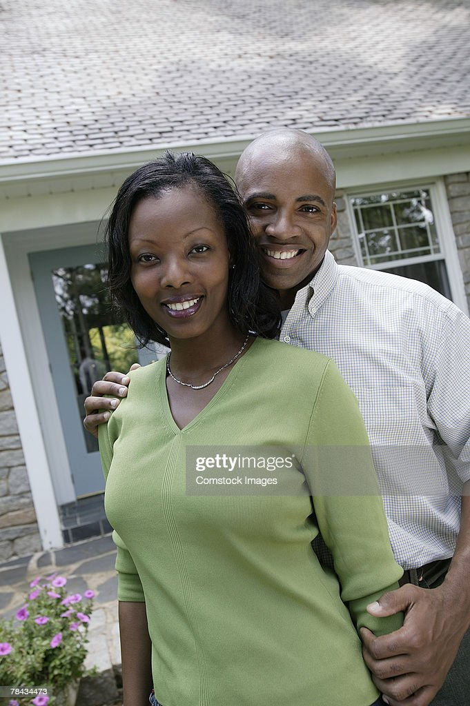 Couple standing outdoors : Stock Photo