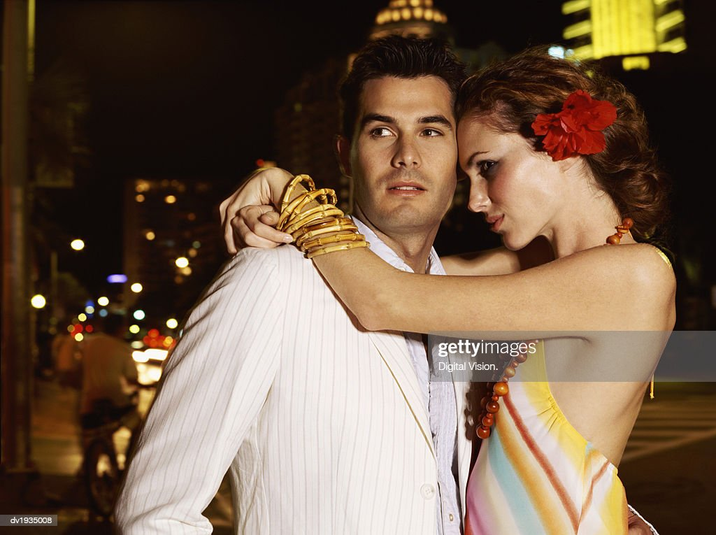 Couple Standing Outdoors, Woman With her Arms Around Him : Stock Photo