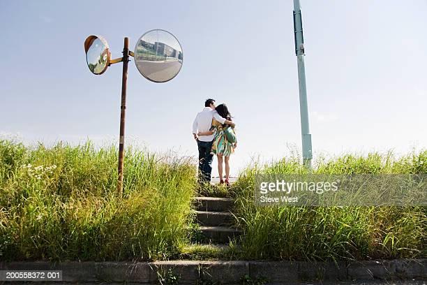 couple standing roadside, rear view - 中年カップル ストックフォトと画像