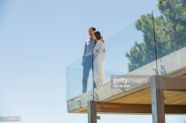 Couple standing together on a terrace