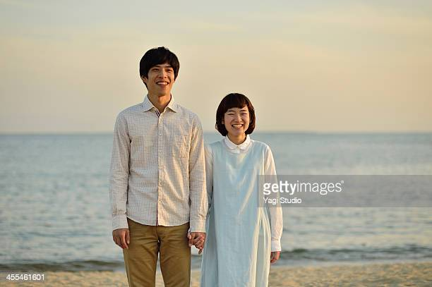 Couple standing together on beach