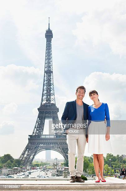Couple standing together with the Eiffel Tower in the background, Paris, Ile-de-France, France