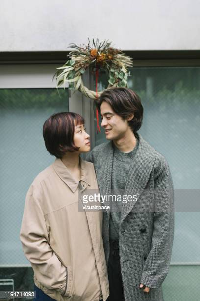 couple standing under shimekazari - vertical stock pictures, royalty-free photos & images