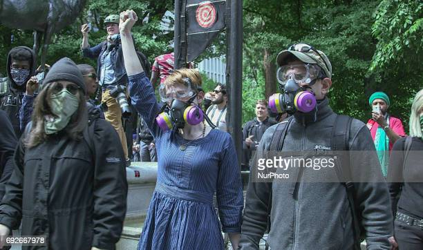 A couple stands against riot police during a free speech rally at Terry Schrunk Plaza in Portland Oregon on June 4 2017