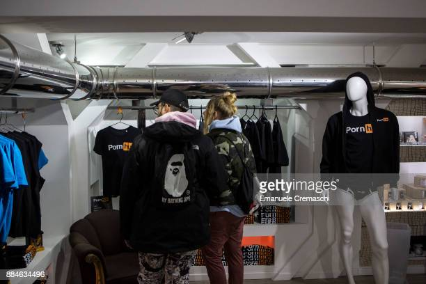 A couple stands at the 'Pornhub Christmas Store' on December 1 2017 in Milan Italy Pornhub the largest pornography site on the Internet has opened a...