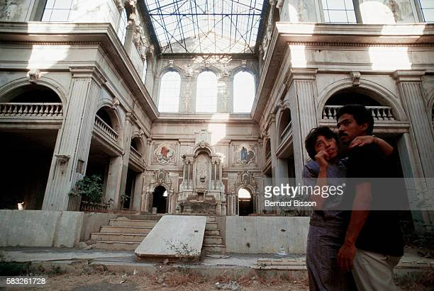 A couple stands in the ruins of the Managua cathedral that was abandoned since an earthquake partly destroyed it