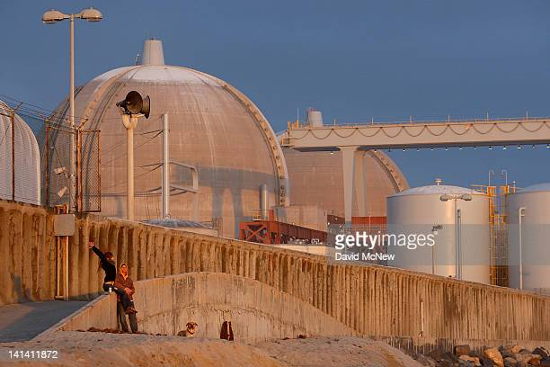 A couple stands near the San Onofre Nuclear Generating Station at San Onofre State Beach on March 15 2012 south of San Clemente California Three...