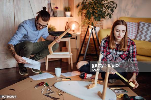 Couple starting to assemble new furniture