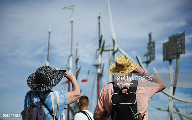 A couple stop to look at the tall ships during the North Sea Tall Ships Regatta on August 27 2016 in Blyth England The bustling port town in South...