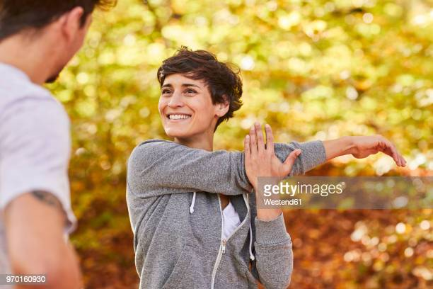 couple stretching in forest - gymnastics poses stock pictures, royalty-free photos & images