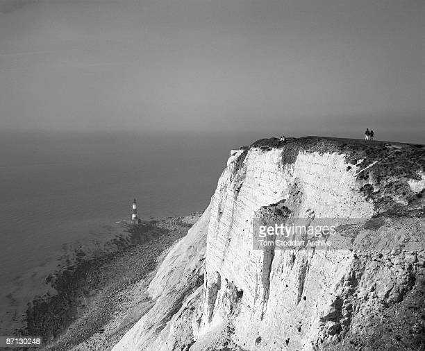 A couple stroll along the chalk cliff at Beachy Head East Sussex April 2007 The chalk cliff is the highest in Britain at 530 feet above sea level It...