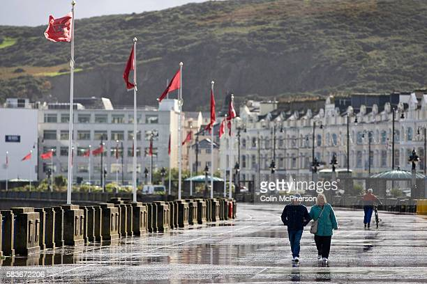 A couple strolling along the seafront at Douglas Isle of Man The island a selfgoverning British Crown Dependency is due to hold elections on...