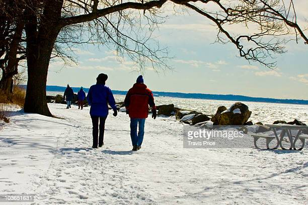 couple strolling on a crisp winter's day - stamford connecticut stock pictures, royalty-free photos & images