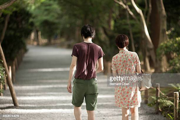 Couple strolling through Japanese garden