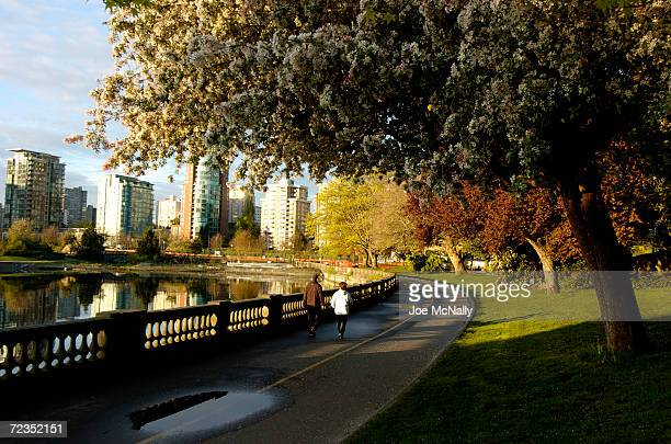 A couple strolls through Stanley Park on a Spring afternoon near the city's main boat marina April 21 2004 in Vancouver Canada Though Canada's third...