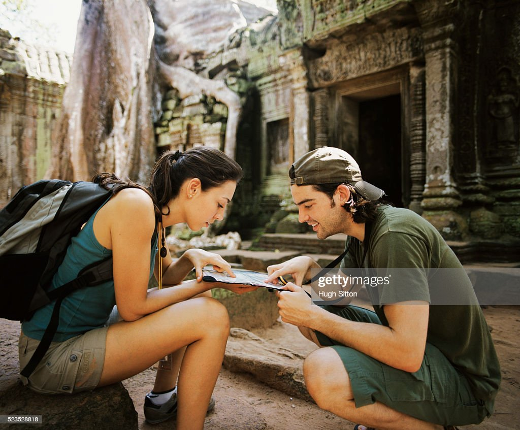 Couple Studying Map at Temple : Stock Photo