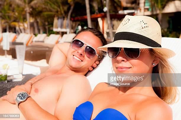 couple sunbathing at playa del carmen, quintana roo, mexico - carmen bella foto e immagini stock