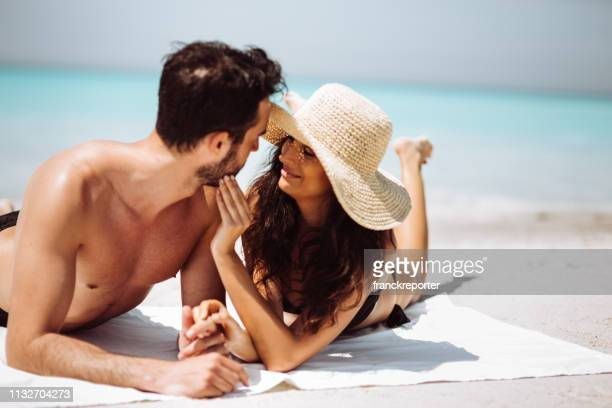 couple sunbathing on the beach - hot women making out stock pictures, royalty-free photos & images