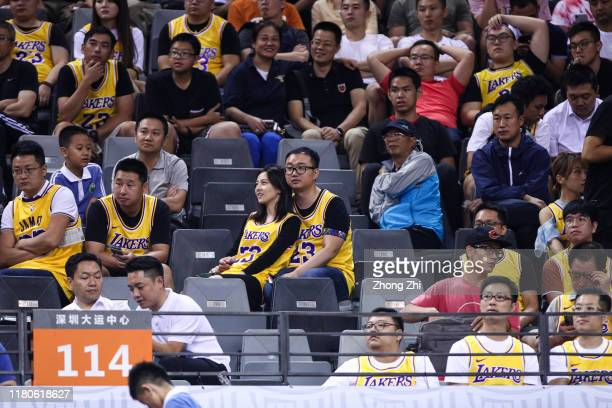 Couple supporters of LeBron James of the Los Angeles Lakers look on during the match against the Brooklyn Nets during a preseason game as part of...