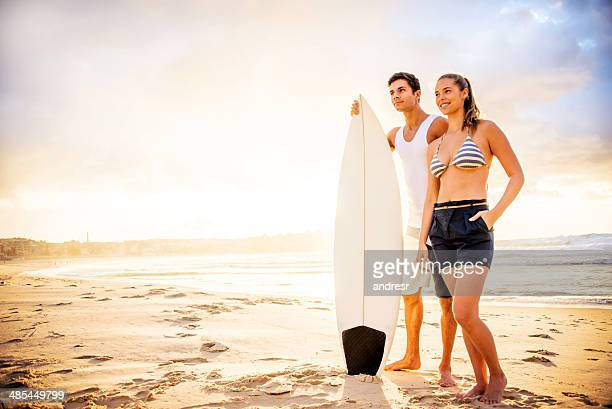Couple surfing at the beach
