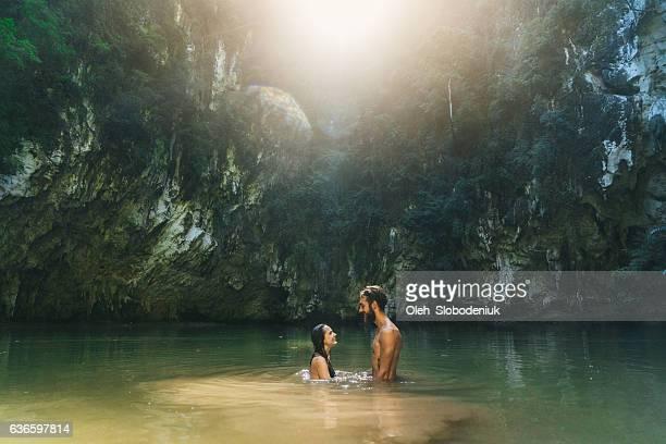 Couple swimming in lagoon