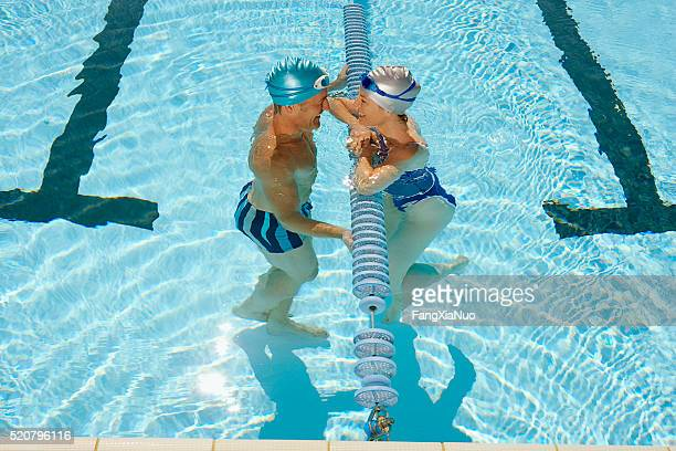 couple swimming - length stock pictures, royalty-free photos & images