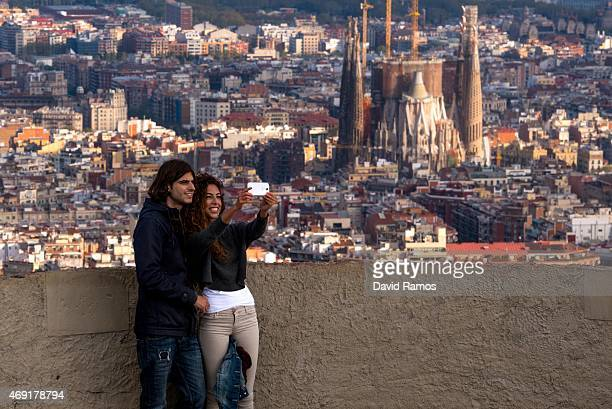 A couple take a selfie as they enjoy the views over the city on April 10 2015 in Barcelona Spain Barcelona's city hall has put a regulation in motion...