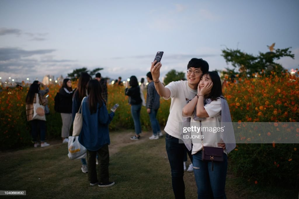A couple take a selfie at Yeouido park in Seoul on September