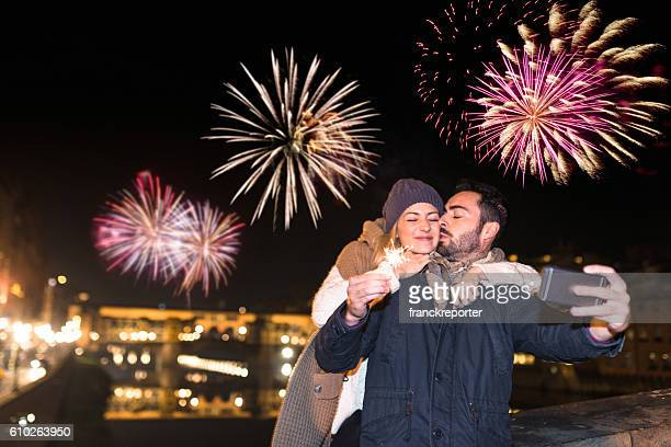 couple take a selfie for the new year