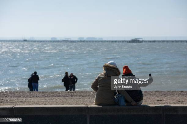 Couple take a selfie on the beach on a very quiet seafront on Mother's day March 22, 2020 in Southend on Sea, England. With the sunny weather,...
